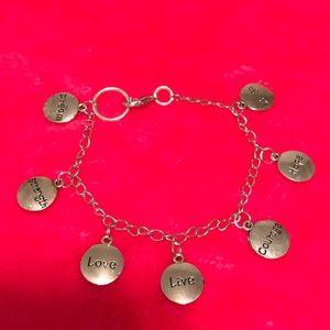 Vintage silver tone bracelet with pendants